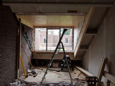 Extra slaapkamer in de carport met een dakkapel