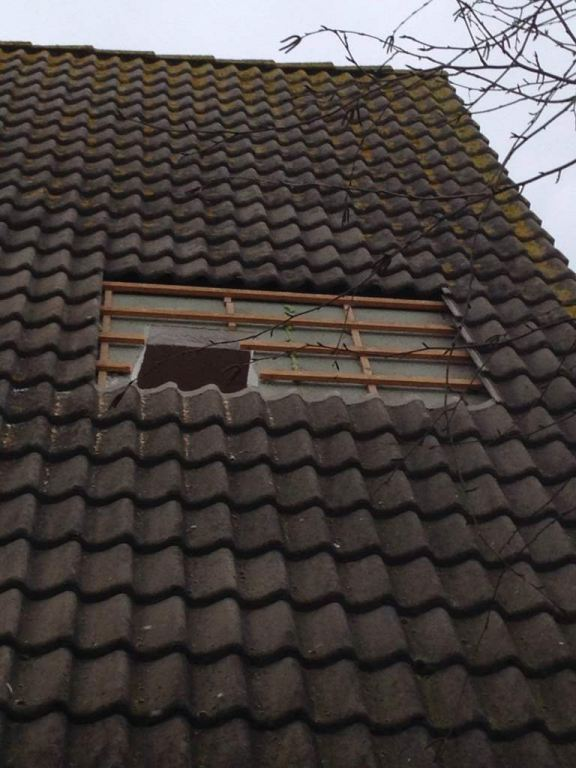 dakraam plaatsen Rotterdam