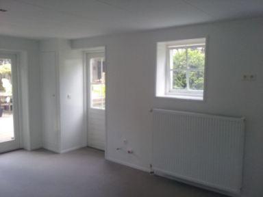 Garage omgebouwd naar atelier, geheel geïsoleerd  met voorzetwanden