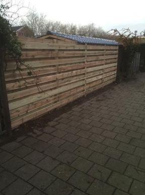 Overkapping maken en plaatsen van een schutting in Schiedam