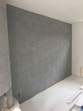 Muren behandelt met betonlook