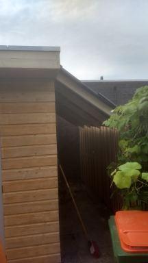 Nieuwe schuur hout met EPDM Breda (afdakje voor haardhout)