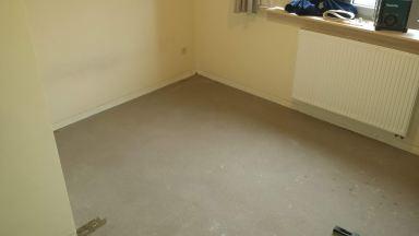 Oude vloer uitgebroken en opkuisen. Vinyl vloer geplaatst in Sint-Niklaas