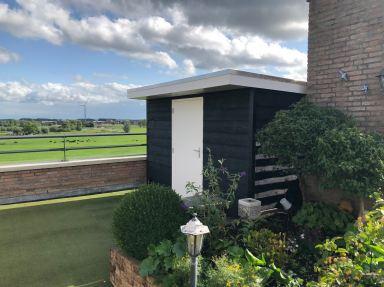 Plaatsen tuinhuis op dakterras in Heemskerk