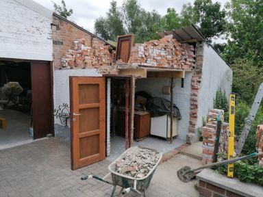 afbraak en heropbouw van bijgebouw