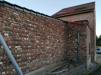 muur opnieuw opgemetseld tongeren