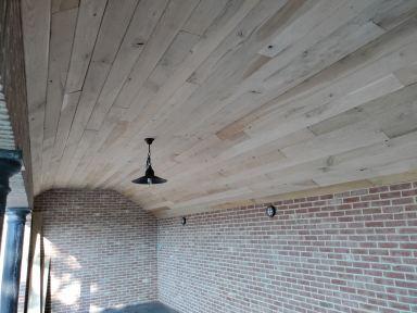 Plafond van terras te Minderhout dichtmaken met eiken planken